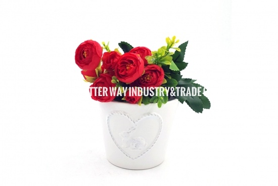 white ceramic cylinder planter